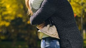 Woman and man embracing in autumn park, meeting after long time parting, love. Woman and men embracing in autumn park, meeting after long time parting, love stock photography