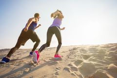 Woman and man during endurance training outdoors royalty free stock images