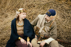 Woman and man in ethnic suit  context historical reconstruction Stock Photo