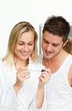 Woman and man examining a pregnancy test Stock Photography