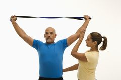 Woman and man exercising. Royalty Free Stock Photos