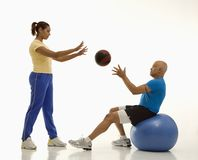 Woman and man exercising. Stock Photo