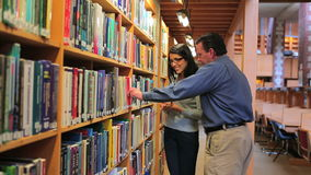 Woman and man finding a book stock video footage