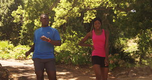 Woman and man are finishing their jogging stock footage