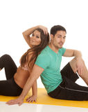 Woman man fitness sit back to back Royalty Free Stock Image