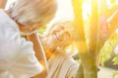 Woman and man flirting in summer. Smiling women and men flirting in summer in the nature Royalty Free Stock Images