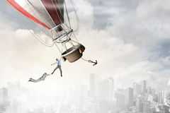 Woman and man flying on aerostat Stock Images