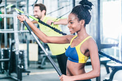 Woman and man in functional training for better fitness. Woman and men in functional training for better fitness in sport gym stock photography