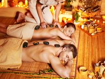 Woman and man getting  massage in spa. Royalty Free Stock Image