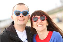 Woman and man with glasses shaped heart, summer time Royalty Free Stock Photography