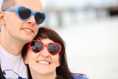 Woman and man with glasses shaped heart, summer time Royalty Free Stock Photo