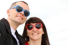 Woman and man with glasses shaped heart, summer time Stock Photos