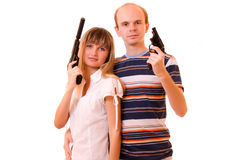 Woman and man with guns. Over white Royalty Free Stock Photos