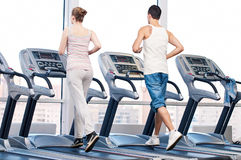 Woman and man at the gym exercising. Stock Photography