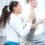 Woman and man at the gym exercising Royalty Free Stock Photography