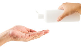 Woman and man hand holding bottle with shampoo Royalty Free Stock Photos