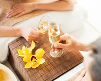 Woman and man hands with champagne glasses stock images