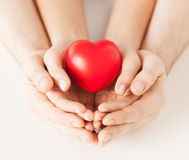 Woman and man hands with heart Stock Photos