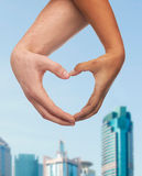 Woman and man hands showing heart shape Royalty Free Stock Photo