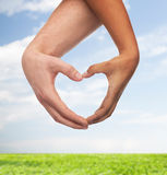 Woman and man hands showing heart shape Royalty Free Stock Photography