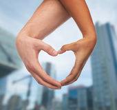 Woman and man hands showing heart shape Stock Photos