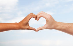 Woman and man hands showing heart shape Royalty Free Stock Photos