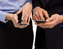 Woman and man hands with smartphones Royalty Free Stock Images