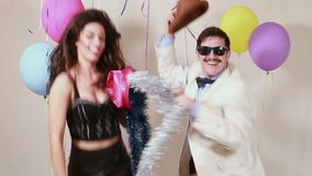 Woman and man having awesome time dancing in photo booth stock footage