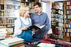 Woman and man having books Stock Photos