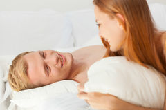 Woman and man having conversation in bed Stock Photography