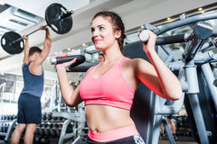 Woman and man having sport training in fitness gym. Woman and men having sport training in fitness gym Royalty Free Stock Photo