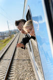 Woman man heads out the train window Royalty Free Stock Photos