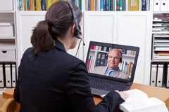 Woman man headsets online chat Stock Images