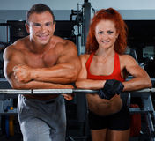 Woman and man in a health club royalty free stock image