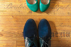 Woman and man hipster shoes view from above. On wood floor Royalty Free Stock Photos