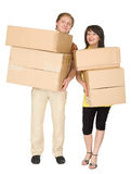 Woman and the man hold boxes Stock Photo