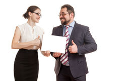 The woman and the man hold a sheet of paper Royalty Free Stock Image