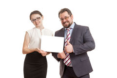 The woman and the man hold a sheet of paper Stock Image