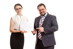 The woman and the man hold a sheet of paper Stock Photo