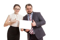 The woman and the man hold a sheet of paper Royalty Free Stock Images
