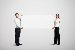 Woman and man holding banner Stock Photography