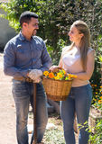 Woman and man holding basket with flowers Royalty Free Stock Image