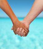 Woman and man holding hands Stock Photos