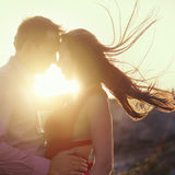 Woman and man holding hands on sunrise. Young couple holding hands on sunrise backlit Stock Photography