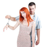 Woman and man  joint by handcuffs Royalty Free Stock Images