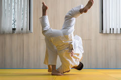 Woman and man judo fighters in sport hall Royalty Free Stock Photos