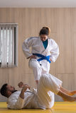 Woman and man judo fighters in sport hall Royalty Free Stock Photography