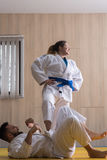 Woman and man judo fighters in sport hall Stock Photos