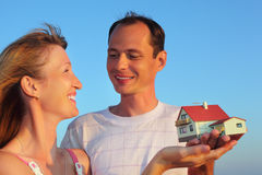 Woman and man keeping in hands model of house Stock Images
