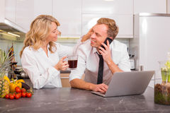 Woman and man in kitchen before going to work royalty free stock image
